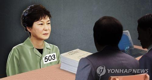 朴槿惠在看守所接受讯问。来源:韩联社。