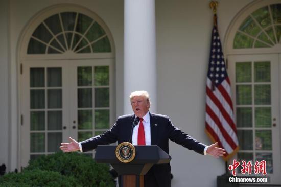 """资料图:当地时间6月1日,美国总统特朗普在白宫宣布,美国将退出《巴黎协定》。他同时强调,美国也许会重返有关应对气候变化的协定,但前提条件是协定必须要对美国更加""""公平""""。 中新社记者 刁海洋 摄"""