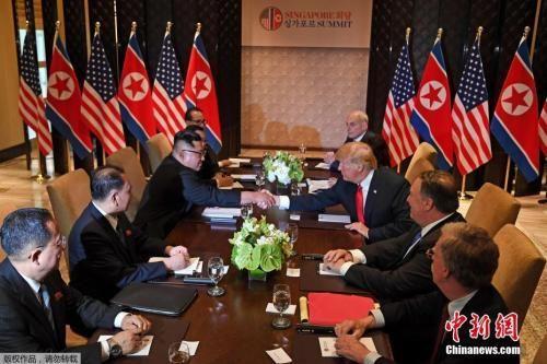 资料图片:当地时间2018年6月12日,朝美举行扩大会谈。
