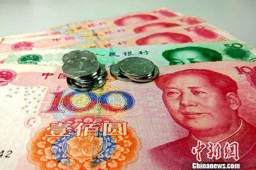 资料图:人民币。李金磊 摄